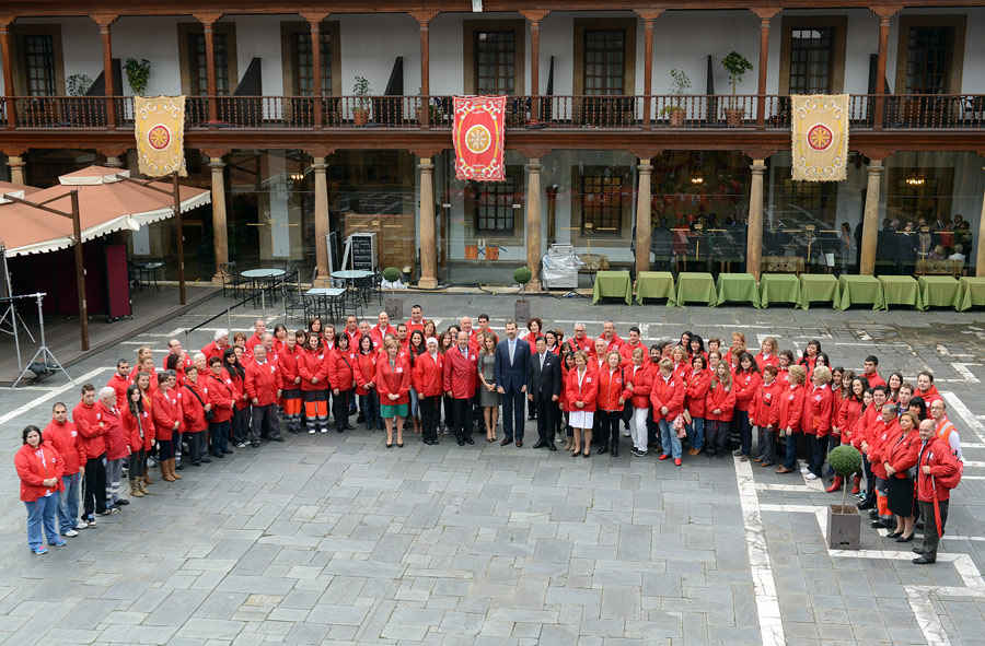 TRH the Prince and the Princess of Asturias with voluntary workers of the International Red Cross and Red Crescent Movement in Oviedo